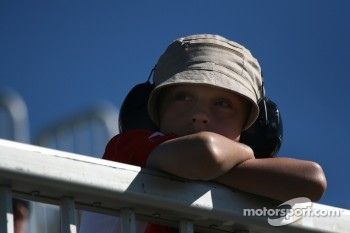 A young fan watches practice action
