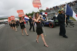The grid girls walk to the starting grid
