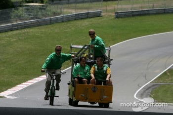 Team Australia crew members drive around the track
