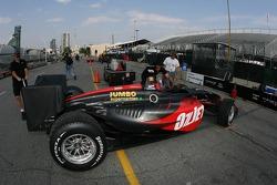 Minardi Team USA crew members take Robert Doornbos' car back to paddock