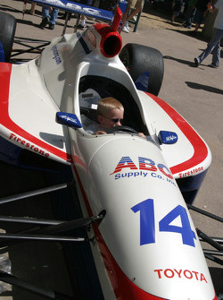 A young fan in the car of A.J. Foyt IV