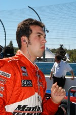 Sam Hornish Jr. watches the timing board