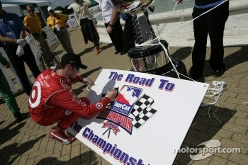 IndyCar Series 2007 Championship contenders Scott Dixon signs a board