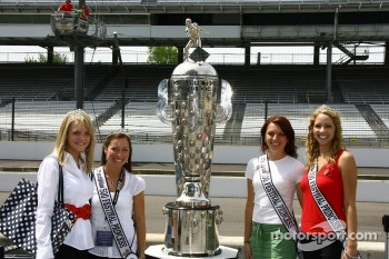 The 500 Festival Princesses pose with the Borg-Warner Trophy at the Indianapolis Motor Speedway on opening day