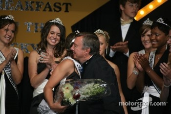 Indy 500 Champion Johnny Rutherford, center, congratulates 500 Queen, Danielle Sylvester