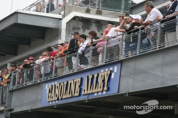 Crowds line Gasoline Alley after the rain delay