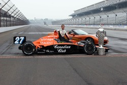 Dario Franchitti and the Cheverolet pace car that is given to the winner of the Indianapolis 500