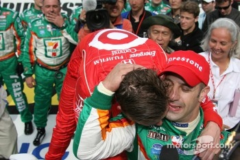 Victory lane: race winner Tony Kanaan is congratulated by Dan Wheldon