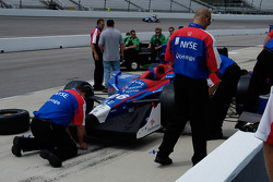 Andretti Green crewmen swarm over Marco Andretti's car