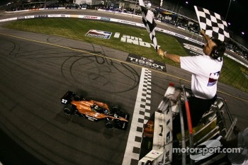 Dario Franchitti takes the checkered flag