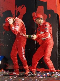 Podium: champagne for Helio Castroneves and Scott Dixon