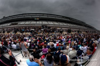 Fans watch drivers meeting