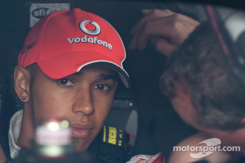 Lewis Hamilton checks out the cockpit of Tony Stewart's car
