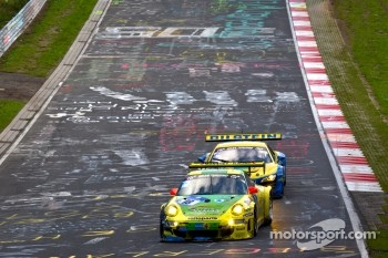 #18 Manthey Racing Porsche 911 GT3 RSR: Marc Lieb, Lucas Luhr, Romain Dumas, Timo Bernhard and #14 Audi Sport Team Phoenix Audi R8LMS: Marc Basseng, Marcel Fssler, Frank Stippler battle