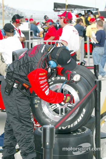 Kelley Racing crew member checking tire