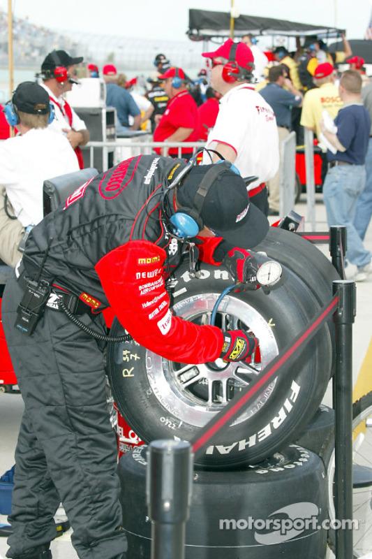 Kelley Racing crew member checking tire