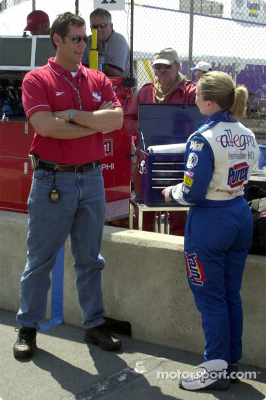 Tony George talking to Sarah Fisher