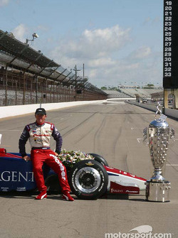 Buddy Rice with his car and the Borg-Warner Trophy