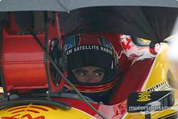 Bryan Herta found shelter under an umbrella