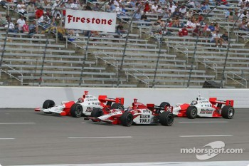 Helio Castroneves, Dan Wheldon and Sam Hornish Jr.