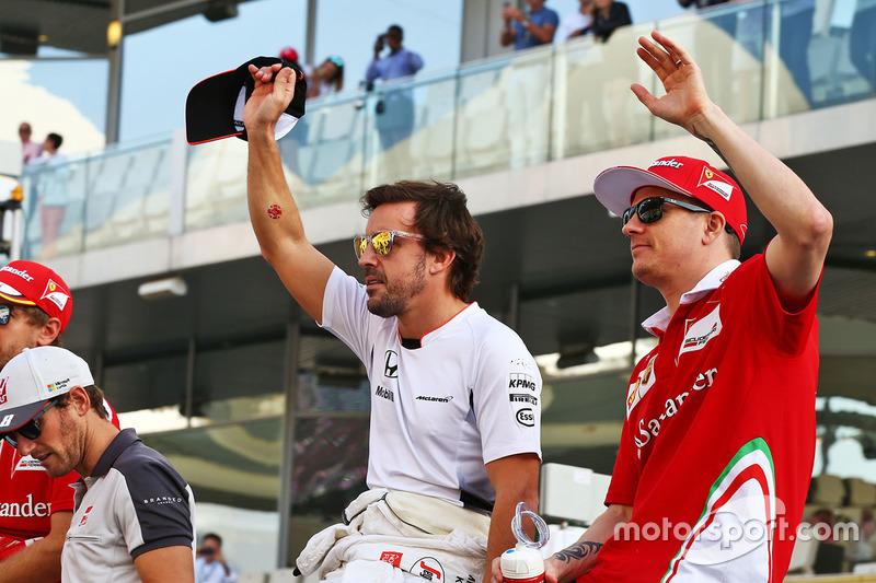 Fernando Alonso, McLaren with Kimi Raikkonen, Ferrari on the drivers parade