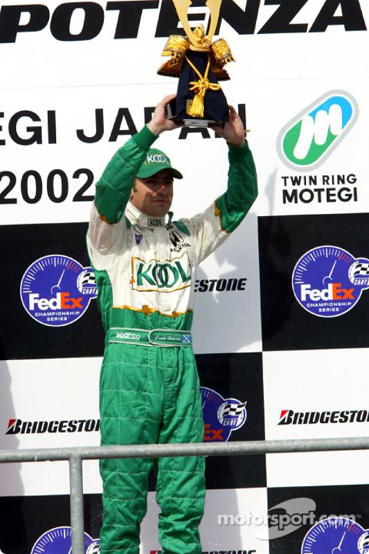 The podium: Dario Franchitti