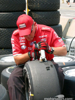 Ganassi Racing crew member preparing the tires