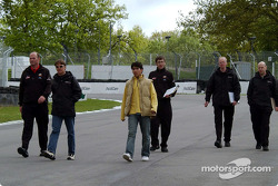 Adrian Fernandez walks around the track