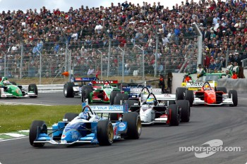 The start: Paul Tracy leads Sébastien Bourdais