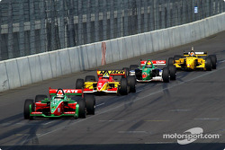 Adrian Fernandez leads a group of cars