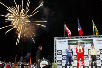 The podium: race winner Sébastien Bourdais with Paul Tracy and Bruno Junqueira under the fireworks
