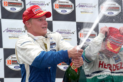 Podium: champagne for Mika Salo