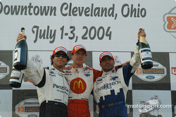 Podium: race winner Sébastien Bourdais with Bruno Junqueira and Alex Tagliani