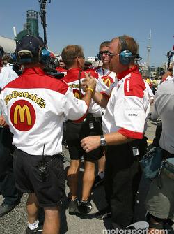 Newman-Haas team members celebrates pole position