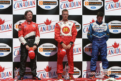 Podium: race winner Sébastien Bourdais with Jimmy Vasser and Patrick Carpentier during National Anthem
