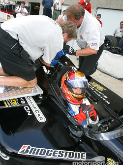 Champ Car 2-seater experience: Patrick Carpentier waits while the crew straps the passenger in