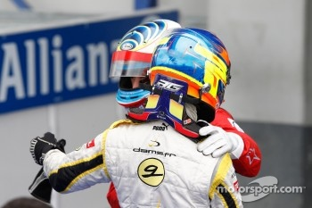 Romain Grosjean celebrates his victory with Luca Filippi