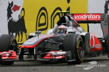 Jenson Button, McLaren Mercedes takes the checkered flag