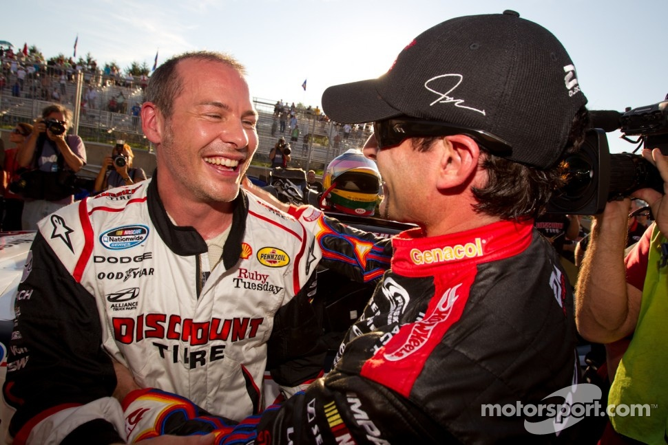 Pole winner Jacques Villeneuve, Penske Racing Dodge celebrates with second place Alex Tagliani, Penske Racing Dodge