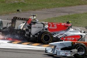 A crash caused by Vitantonio Liuzzi, HRT F1 Team including Vitaly Petrov, Lotus Renault GP