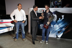 Bruno Michel and Will Buxton with 2011 GP2 Series Champion Romain Grosjean collects the GP2 Champion Trophy