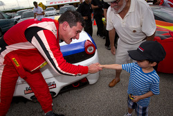 Race winner #22 Ferrari of Ft. Lauderdale Ferrari 458 Challenge: Enzo Potolicchio celebrate with a young fan