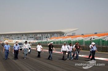 Herbie Blash, FIA Observer, Charlie Whiting, FIA Safety delegate, Race director & offical starter walks the track