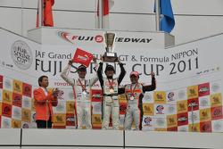 GT300 race 1 podium: winner Nobuteru Taniguchi, second place Tomonobu Fujii, third place Kosuke Matsuura