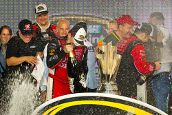 Victory lane: NASCAR Sprint Cup Series 2011 champion Tony Stewart, Stewart-Haas Racing Chevrolet tries to open his bottle of champagne