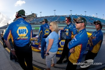 Martin Truex Jr., Michael Waltrip Racing Toyota watches Carl Edwards, Roush Fenway Racing Ford as he is on his flying lap