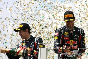 Podium: race winner Mark Webber, Red Bull Racing and second place Sebastian Vettel, Red Bull Racing