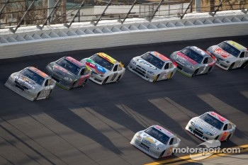 Mark Martin, Michael Waltrip Racing Toyota and Jeff Burton, Richard Childress Racing Chevrolet lead the pack