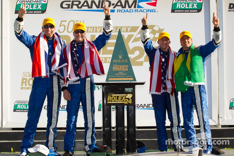 DP victory lane: class and overal winners A.J. Allmendinger, Oswaldo Negri, John Pew and Justin Wilson celebrate