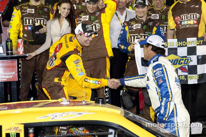 Victory lane: race winner Kyle Busch, Joe Gibbs Racing Toyota celebrates with Michael Waltrip, Michael Waltrip Racing Toyota